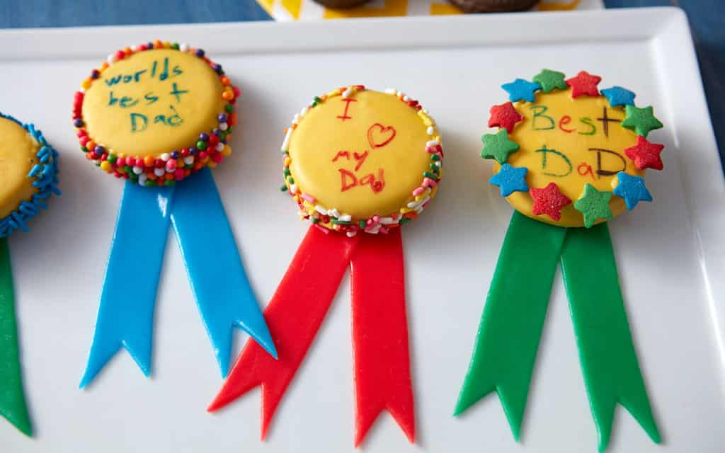 Cookie Awards with child's messages to Dad written on candy dipped cookies with taffy ribbons.