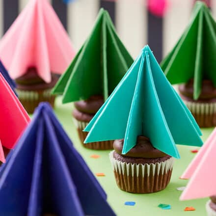Colorful Candy Melt Christmas Tree Toppers on Cupcakes
