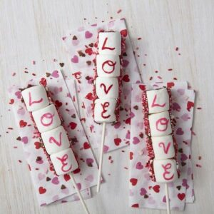 """Valentine's Day """"L-O-V-E"""" marshmallow pops with red and pink sprinkles"""