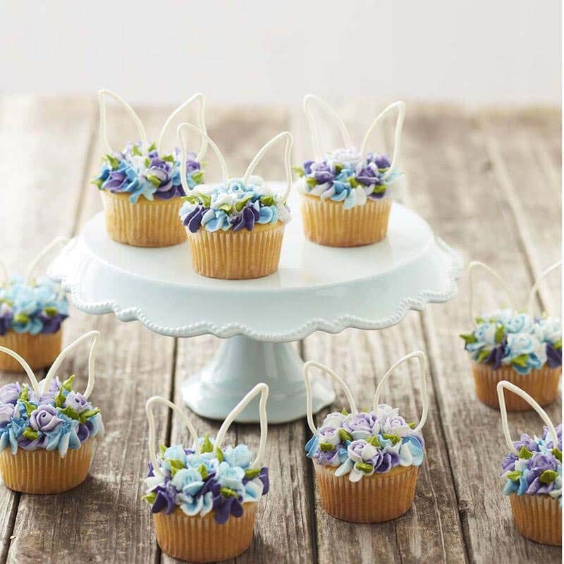 Blue floral cupcakes topped with white Candy Melt bunny ears - Easter dessert ideas