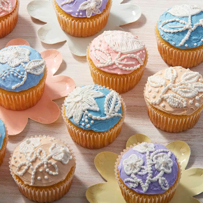 Spring cupcakes with piped flowers that look like embroidery