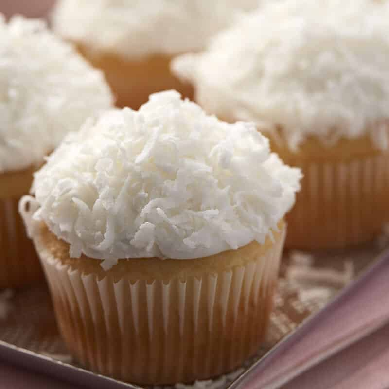 Almond flavor cupcakes topped with shredded coconut
