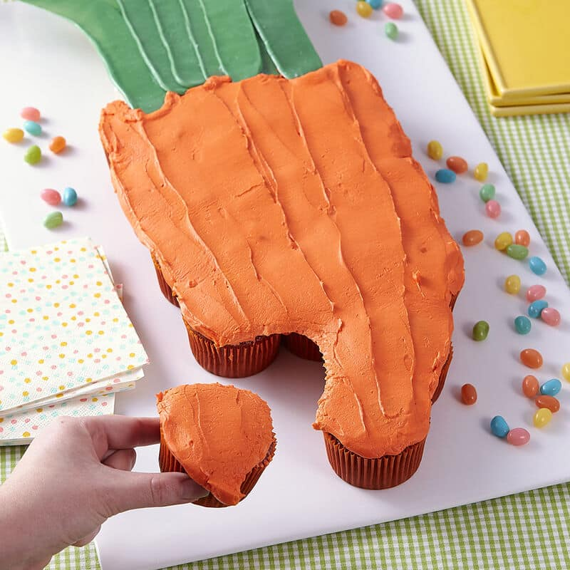 pullapart carrot cupcakes aligned in the shape of a carrot