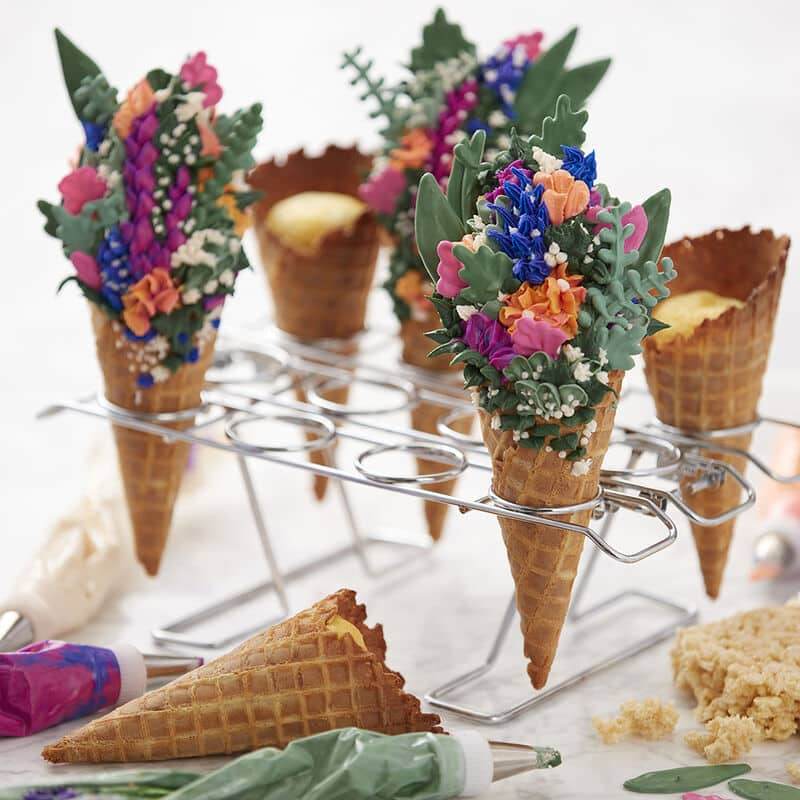 ice cream cones decorated with spring floral frosting