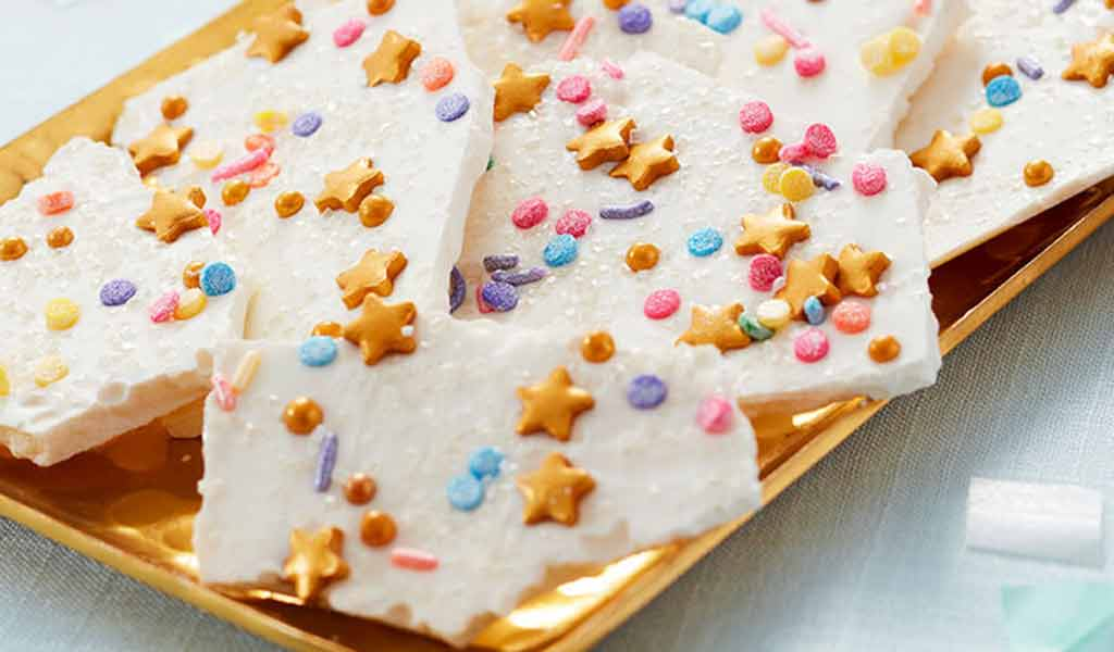 Unicorn candy bark, using white candy melts and an assortment of sprinkles