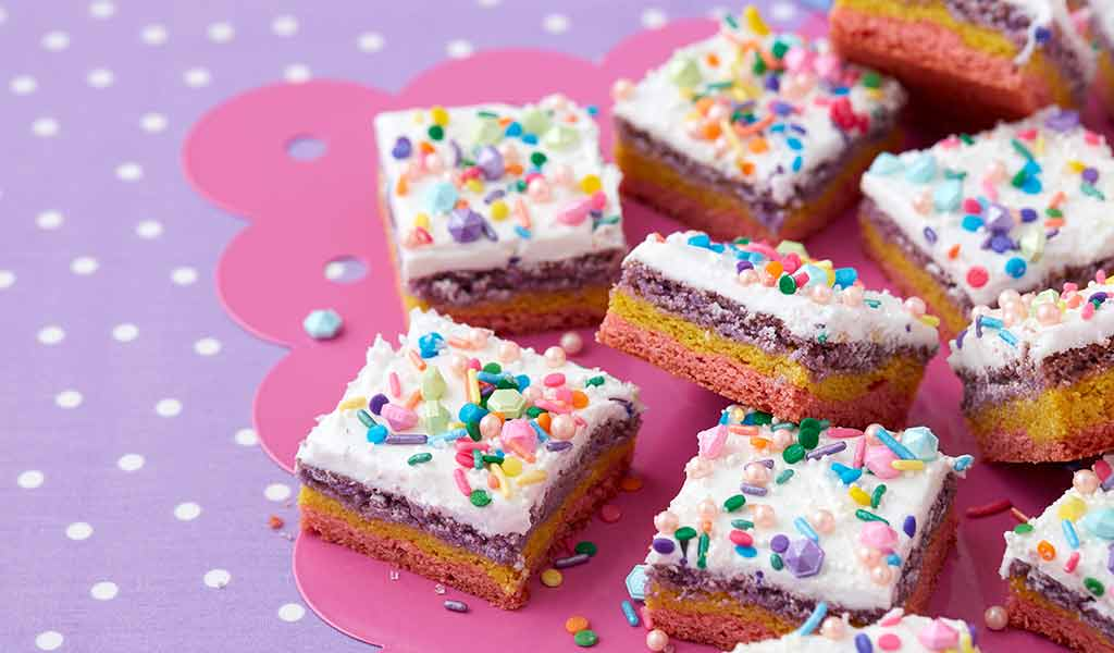 cookies bars decorated with white candy melts candy and multi color sprinkles